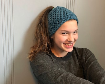 Blue ponytail crocheted hat