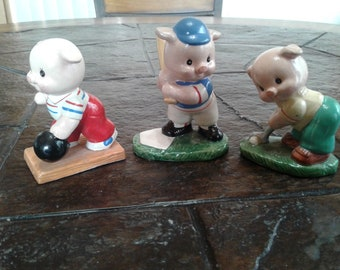 Vintage Three little pigs playing sports figurines