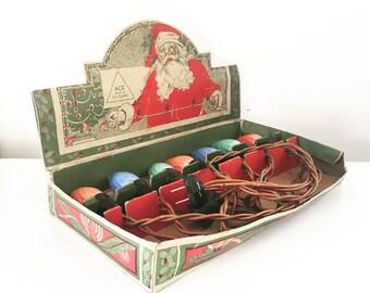 Les lumières de Noël de plein air Ace Vintage, ampoule 7 brin, C9 GE flamme tourbillonnent ampoules, boite d'origine père Noël