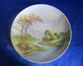 Vintage Nippon Plate with a Hand Painted scene of 2 Trees by a River and Mountains, Decorative Wall-hanging