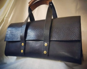 Toolbag tote, in hand stitched black leather.