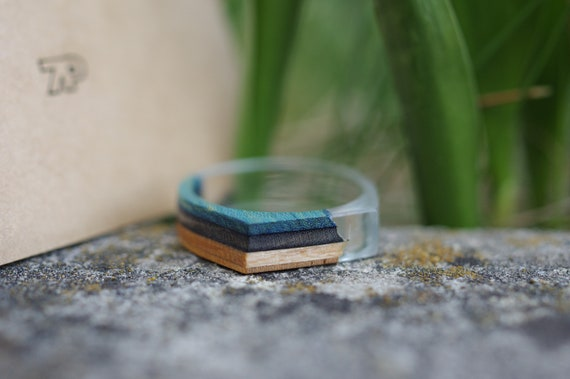 resin and recycled SKATEBOARD blue black wood ring
