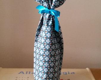Turquoise patterned bottle bag