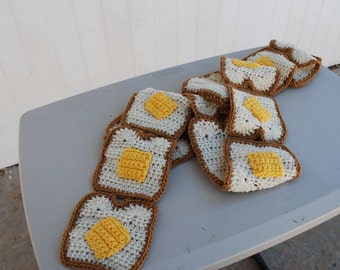 Crocheted buttered toast scarf