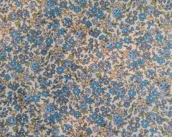 Fabric cotton blue background with flowers