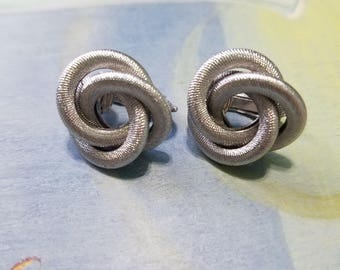 Vintage silver tone twisted knot, Sarah Coventry clip on Earrings