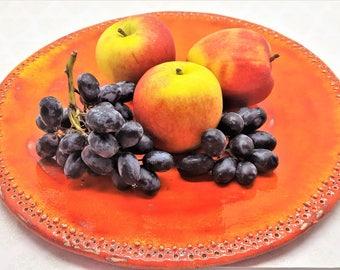 Large round orange ceramic platter. Handmade chunky pottery serving plate. Mediterannean style tableware. Fruit dish. Decorative home decor.