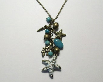 """Fabulous vintage seashore necklace. Starfish, shell, coral, with turquoise and bronze accent beads on a 30"""" antiqued bronze chain."""
