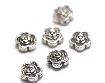 "10 pearls has ""puck flower 1"", 7 x 3 mm, silver, 079"