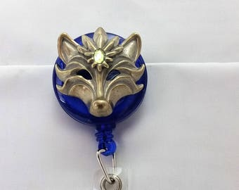Vintage fox with green stone badge reel