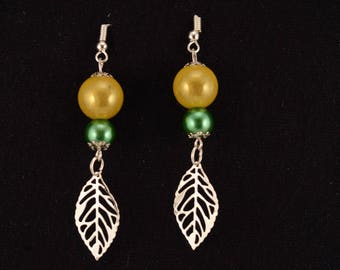 Green beads and silver leaf earrings