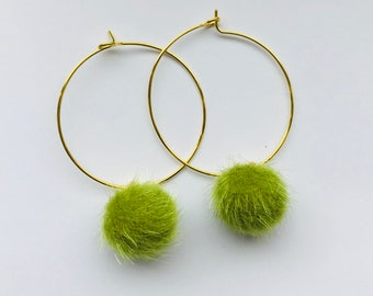 Green pompom hoop earrings
