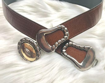 brown belt with brass buckle
