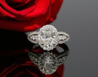 9x7mm Oval Forever One Moissanite and Diamond Halo Engagement Ring in 14k White Gold (avail. in rose, white, yellow gold and platinum)