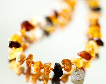 Personalized Baby teething necklace from mixed colour Baltic amber