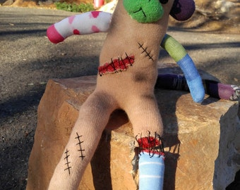 Sock Zombie Monkey made from parts of other monkeys - head gash, dangling eye, gut wound & severed leg