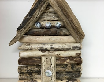 Driftwood beach hut wall hung