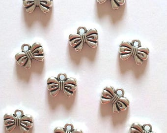 Set of 25 knots T 26 silver charms