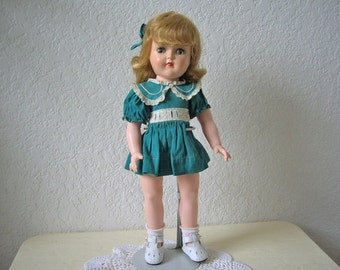 Toni Doll made by the Ideal Doll Co in the late 1940s. Hard Plastic. Wearing Original Dress. Great Condition