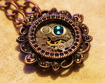 Steampunk Jewelry - Pendant - Watch movement and dark aqua crystal - Antique copper