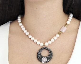 handmade necklace made of natural pearls and rose quartz