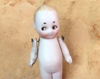 darling side glancing kewpie doll