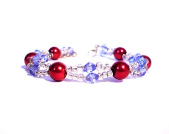 Bracelet red, blue and transparent beads