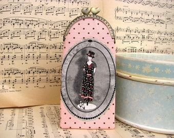 Vintage eyeglass case with figurine on dots, kiss lock case