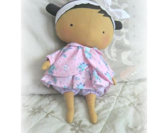 Toy doll with clothes
