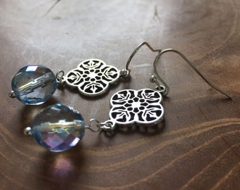 Water - Pair of dangling earrings with decorative, silvertone charm and blue glass bead with AB shine.