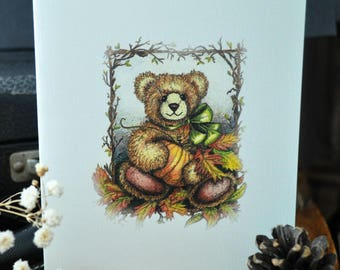 Four Blank Note Cards of Cute Autumn Teddy Bear Sitting with a Pumpkin and Autumn Leaves. Stored in a Clear Envelope and Tied with Raffia