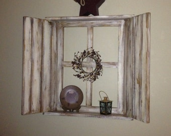 Rustic wood window frame, 4 pane, with shutters attached, top and bottom shelves.