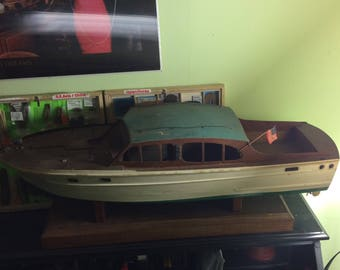 Antique hand made boat model with stand.