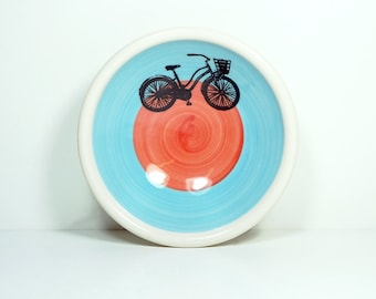 "small dish, with what we like to call the ""speedy delivery"" bike shown here on a color block of sky blue & red-orange, made to order."