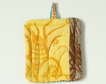 bright gold yellow and brown natural linen hot pad hand dyed and printed with with corn and grass