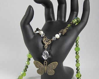 Chlorophyll; Necklace Inspired by Nature's Elegance in Green Glass Pearls & Cut Glass with a Buttefly Framed by Crystal and Vintage Pearls
