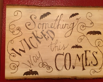 Something wicked this way comes woodburned sign