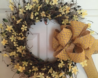 Wild and  Rustic Blueberry Wreath highlighted with soft yellow silk Spring flowers.