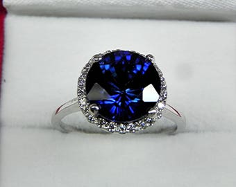 AAAA  Blue Sapphire  10mm  5.00 carats   in 14K White gold Diamond Halo ring with  .25 carats of diamonds MMM