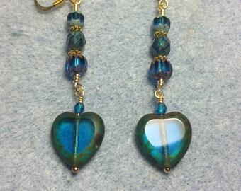 Blue green Czech glass heart bead dangle earrings adorned with blue green Czech glass beads.