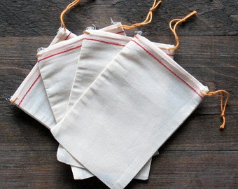 100 4x6 inch Cotton Muslin Bags With Red Hem and Orange Drawstrings