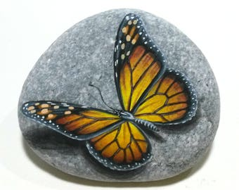 Stone painting art monarch butterfly! Painted on natural flat sea stone with acrylics and finished with glossy varnish. Butterfly home decor