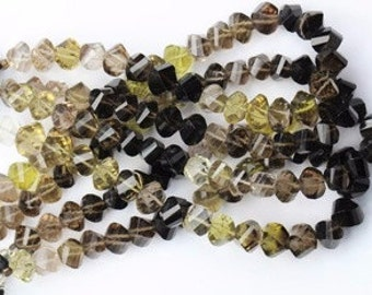 very good  quality gemstone 8 inch long strand of SMOKY TWISTED BEADS 6.5 x 8 mm