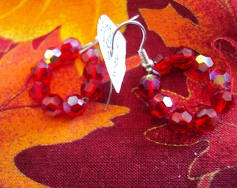 REDUCED  Irridescent Handmade Red Glass Circle Earrings.