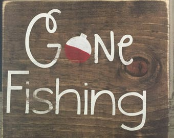 Gone fishing wood sign with bobber