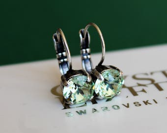 Antique Silver Plated Leverback Earrings made with Chrysolite Green Swarovski Crystal Elements. Earrings by Lady C