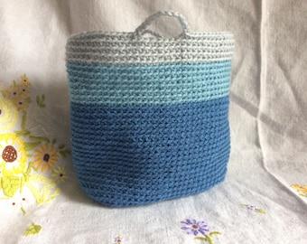 Hand crocheted storage basket in sky blues