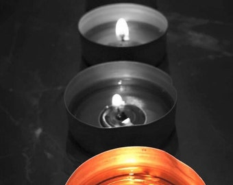 Candles are in black and white life and color.