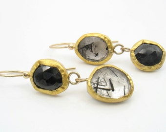 Absolutely One Of A Kind breathtaking earrings. The stones are set inversely to create a stunning and unique pair of earrings. Solid 22k