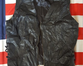 Badass Wilson's vintage 1980s real leather biker babe vest. Corset laced sides, zip front.